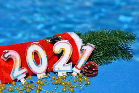 Christmas decorations and pine branch 2021, on the background of the pool.