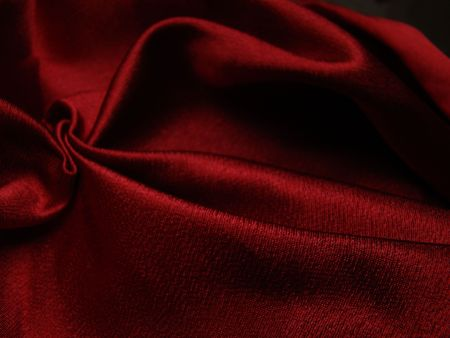 to creep: texture of red satin creep