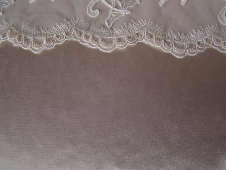 textil and Detail on the top of  bridal embrodery  satin