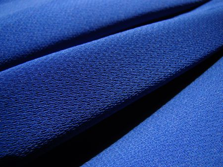 Macro detail texture royal blue crepe fabric diagonally