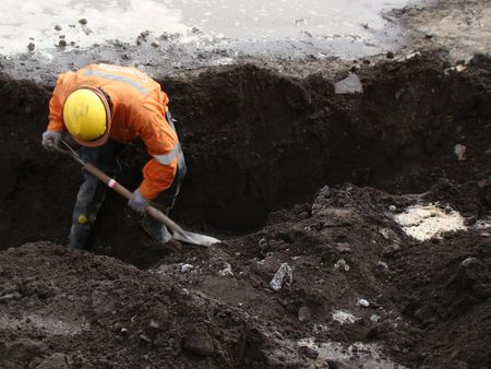 man working street sewer reconstruction of post earthquake Talcahuano Chile                             Editorial