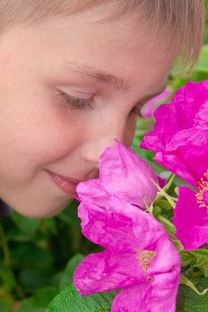 portret: Portret of little  boy smelling  flowers outdoors