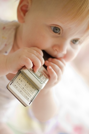 Portret of little  girl with phone Stock Photo - 9365733