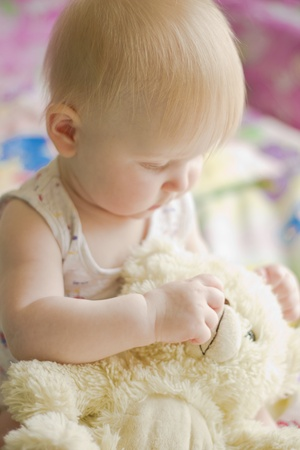 Portret of little  girl with teddy bear Stock Photo - 9362289