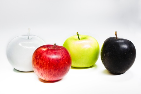 White, green, red and black apples isolated on white photo