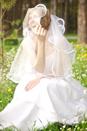 Happyl young bride on meadow photo