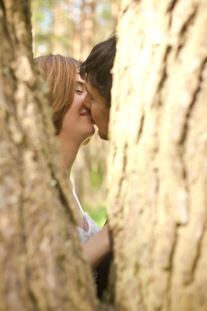 love kissing: Beautiful young bride kissing with  her groom Stock Photo