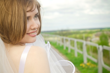 Happy smiling young bride  photo