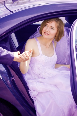 Beautiful young bride in the car photo