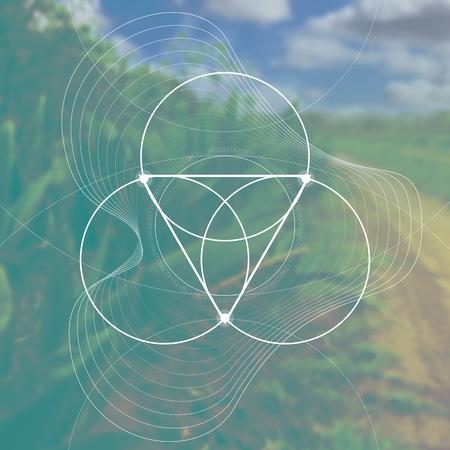 Flor de la vida - el símbolo antiguo de los círculos que se enclavija delante del fondo fotorrealista borroso de la naturaleza. Geometría sagrada: matemáticas, naturaleza y espiritualidad en la naturaleza. La fórmula de la naturaleza.