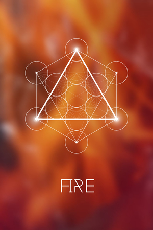 Sacred geometry Fire element symbol inside Metatron Cube and Flower of Life in front of natural blurry background.