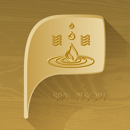 spa resort: bubble golden icon with spa accessory oil on brown wooden background. Spa resort.