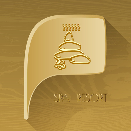 spa resort: bubble golden icon with spa accessory stones on brown wooden background. Spa resort.