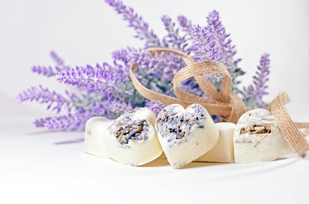 bunch of hearts: Spa soap hearts with a lavender flowers and flax ribbon Stock Photo