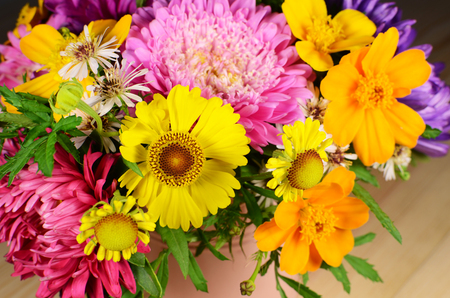 pot marigold: Multi-colored bouquet of different autumn flowers background Stock Photo