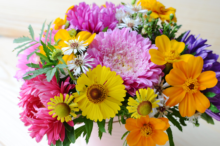 pot marigold: Multi-colored bouquet of different flowers in the pot Stock Photo