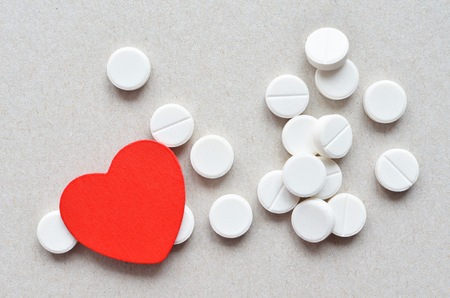 depressant: a lot of white cardio tablets healthy heart concept