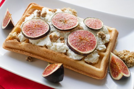 Vienna wafer dessert with ricotta and fresh figs on white plate background, healthy dessert concept