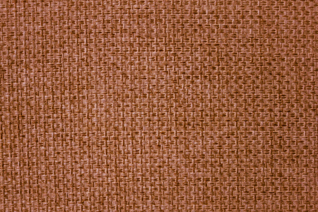 The texture of mats is brown. Large threads, close-up weaving.