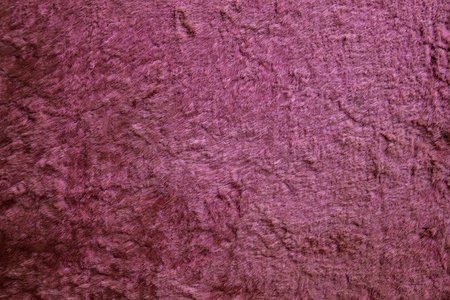 outworn: Old, burnt plush. Crushed pile of pink color. Incomplete coating, soft texture. A vintage thing. Stock Photo
