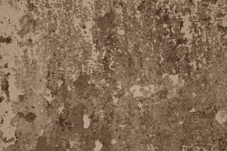 Gray concrete surface with shabby white paint. The old wall of the building.