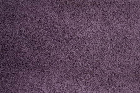 Homogeneous background of purple suede. A small pile, quality workmanship. The use of natural leather, furrier art.