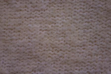 Knitted background, purl loops. White color, no picture. Fluffy, warm, natural wool. Machine knitting. Banco de Imagens