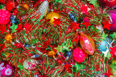 Bright decorations, tinsel, balls and bumps for the New Year tree. Red, green, gold and silver colors. Brilliant glass toys.