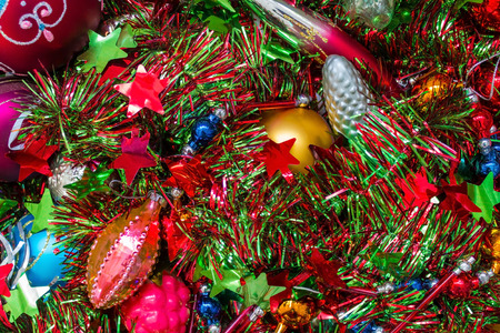 Festive, elegant decorations for the New Year tree. Glass, shiny, bright toys of different sizes and colors. Daylight.