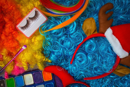 Colorful bright overhead hair, make-up, New Years accessories. Preparing for a festive party, fancy dress. Daylight illumination.