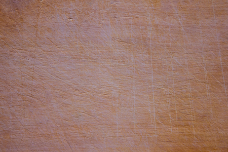 Natural, unprocessed board made of wood, kitchen utvat. On a light background, marks from the knife, scratches, small nicks. 写真素材