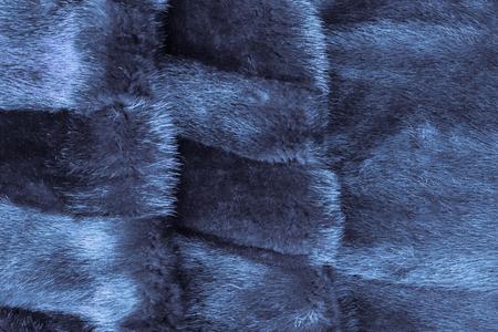 Winter outerwear of sheared mink fur. Rich, dense pile. Blue toning, daylight. Stock Photo