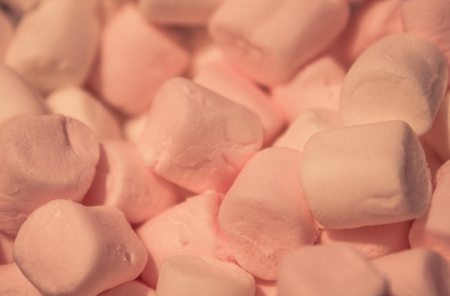 Delicate marshmallow slices. Delicious, airy dessert. Favorite baby treat. Close-up, background is blurred.