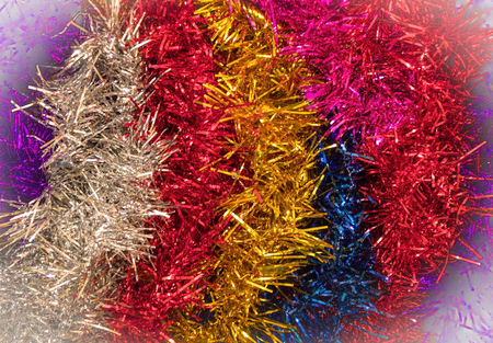New Years tinsel, a brilliant decoration for the house. Waiting for the holiday, preparing for the celebration. Light vignetting.