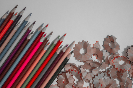 A number of sharpened pencils, some of them are bright red shades, the others are gray. Creativity in the team, work in the office.