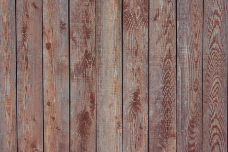 Old brown boards, street fence, wooden flooring. Brown toning, natural lighting.