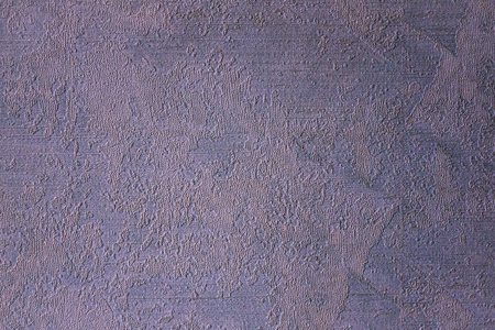 A calm gray texture without a pattern. Purple toning. Surface of the wall, interior finish. Daylight.