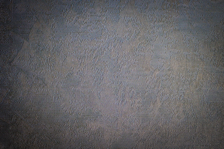 Gray matte background, calm texture. Interior decoration of the room. Vignetting.