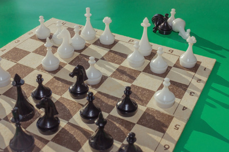A game is played on the chessboard. Part of the figures lie next to the board. Black horse in center field. Complex position, combination. Consider the next move.