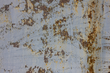 The old cement surface is light colored. Under the shabby paint gray concrete. Above scratched stripes, uneven texture.