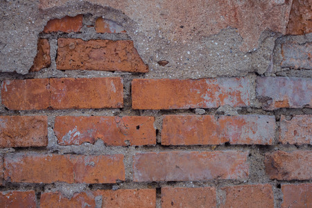 Brickwork, on top of pieces of cement. Dirty, shabby surface, rough work. Construction industry, mason's work. Daylight. 写真素材