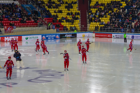 Khabarovsk  Russia - 01.31.2018: Russian national ice hockey team before the game. Players have a red uniform, clubs. Behind the spectators in the stands. Editorial