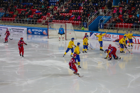 Khabarovsk  Russia - 01.31.2018: Ice field, sports arena. The Swedish and Russian teams are playing. On the ice hockey players, goalkeeper. In the stands spectators. Editorial