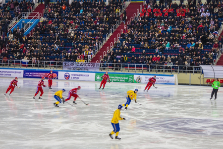 Khabarovsk  Russia - 01.31.2018: Ice arena, players of hockey teams, sports referee, stands with spectators. Match Russia - Sweden, the World Bandy Championship, the second period. Editorial