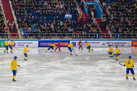 Khabarovsk  Russia - 01.31.2018: On the ice hockey players in yellow and red uniforms. The second period of the match, the Swedish team in defense. World Championship Bandy.