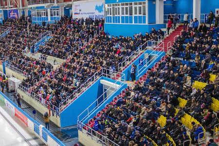 Khabarovsk  Russia - 01.31.2018: The ice arena for winter sports, the World Bandy Championship. Many spectators, full of stands. artificial lighting, top view.
