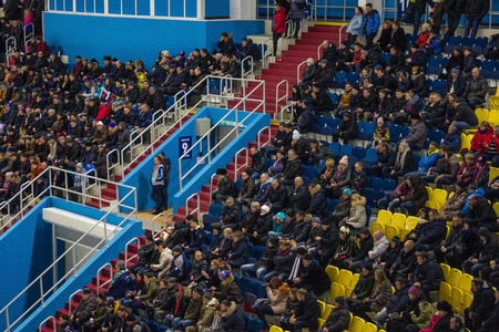 Khabarovsk  Russia - 01.31.2018: Spectator seats in the stands, all in warm clothes, winter, cold season. World Bandy Championship, ice arena. Excitement, worry for the team.