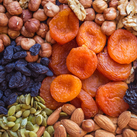 Products of vegetarian cuisine, nuts and dried fruits. Balanced diet, special diet. Warm tones, top view.