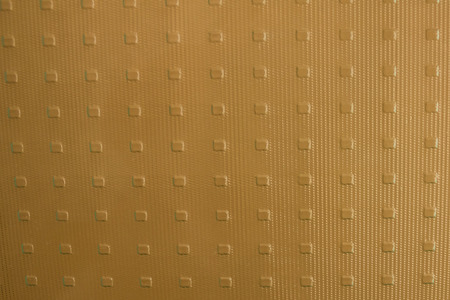Opaque, frosted glass, neutral, calm drawing with small squares. Bronze, beige, golden, brown shade, daylight.