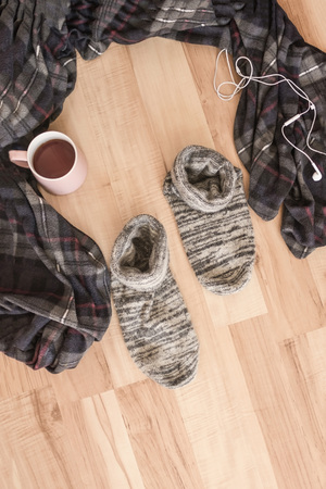 A conscious choice, a way out of the comfort zone, a craving for change of places. On the wooden floor there was a cozy plaid and comfortable socks. Nobody here. Stock fotó